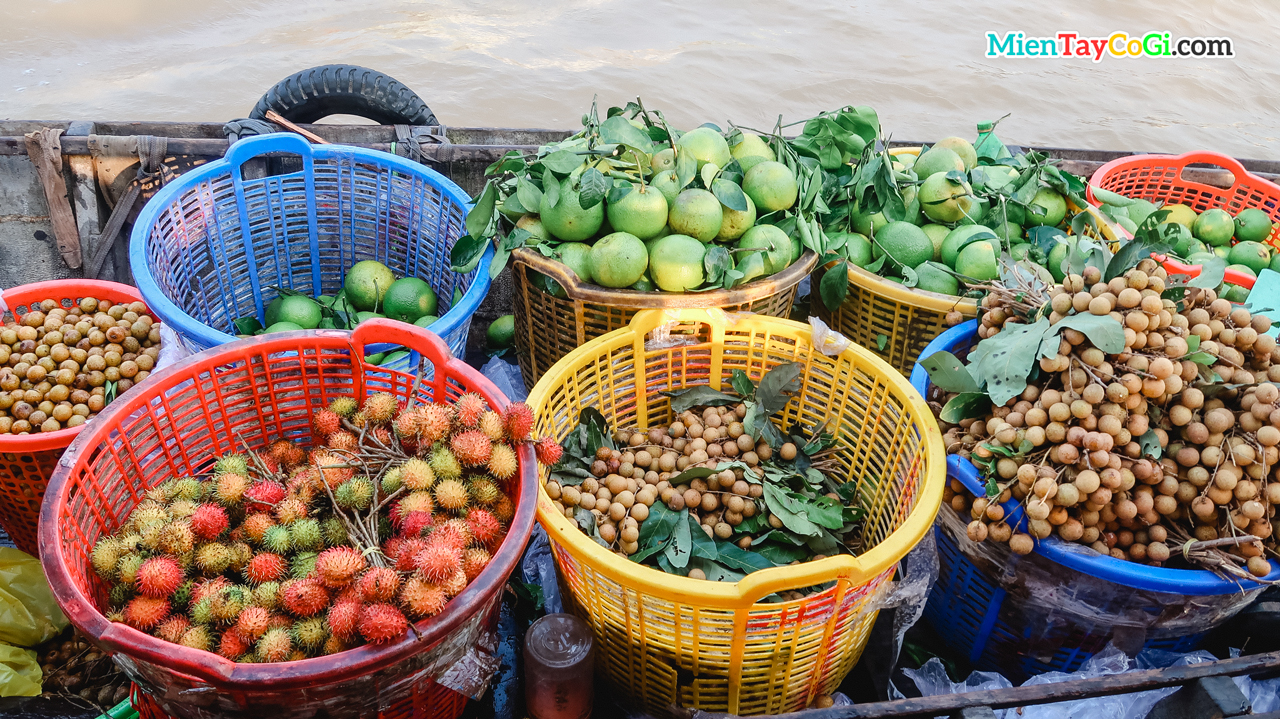 Fruit baskets on boats at Cai Rang floating market Vietnam