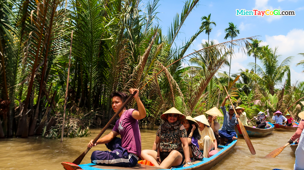 Tourists enjoy sitting in a canoe to explore the river