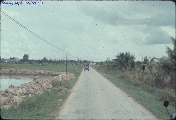 Con đường quốc lộ ở Châu Đốc năm 1965   Photo by Robert D